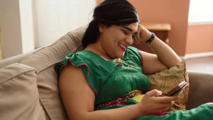 a happy Hijra on a couch
