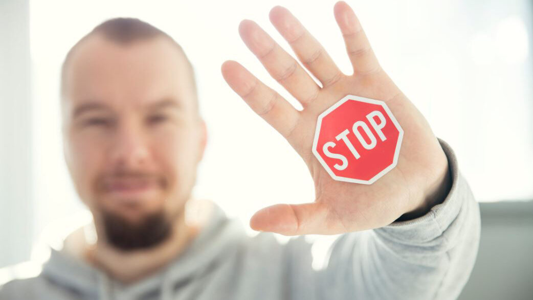 guy with a stop in the hand